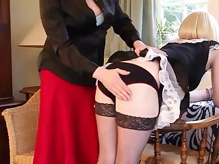 Crossdresser Mistress Luci May spanks blonde tranny maid tight ass giving her lovely peachy red bum