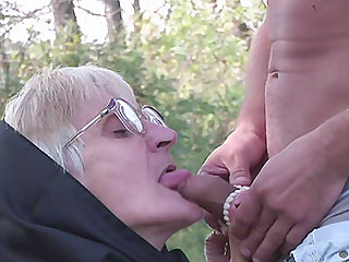 Blonde granny with glasses blows and rides cock outdoors