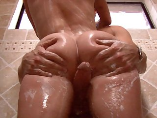 Amy Brooke takes a huge cock hardcore in the showers close up